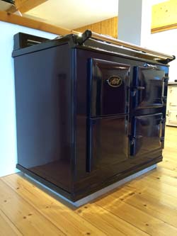 Two Oven Economy 7 (30amp) Electric AGA Cooker on a plain concrete plinth